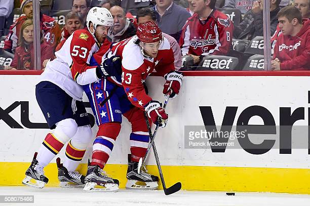 Tom Wilson of the Washington Capitals and Corban Knight of the Florida Panthers battle for the puck along the boards in the second period during...