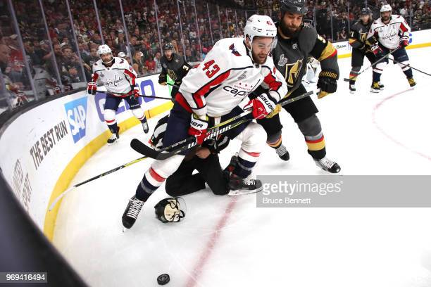 Tom Wilson of the Washington Capitals and Deryk Engelland of the Vegas Golden Knights battle for the puck during the third period in Game Five of the...