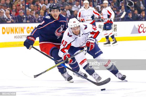 Tom Wilson of the Washington Capitals and Zach Werenski of the Columbus Blue Jackets skate after the puck during the first period in Game Six of the...