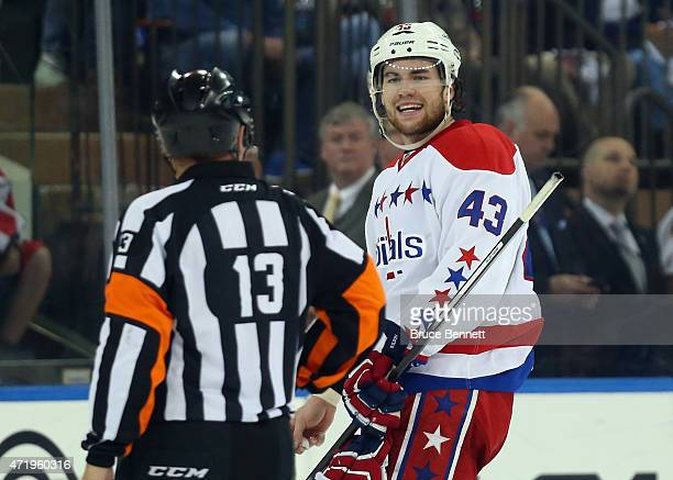 Tom Wilson of the Washington Capitals argues his first period charging penalty against the New York Rangers with referee Dan O'Halloran in Game Two...
