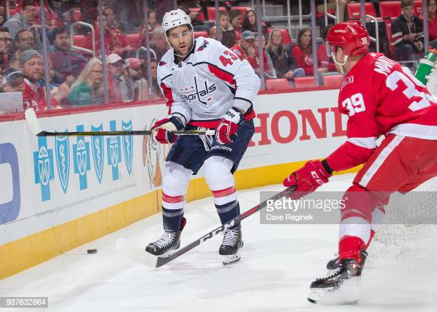 Tom Wilson of the Washington Capitals battles for position with Anthony Mantha of the Detroit Red Wings during an NHL game at Little Caesars Arena on...