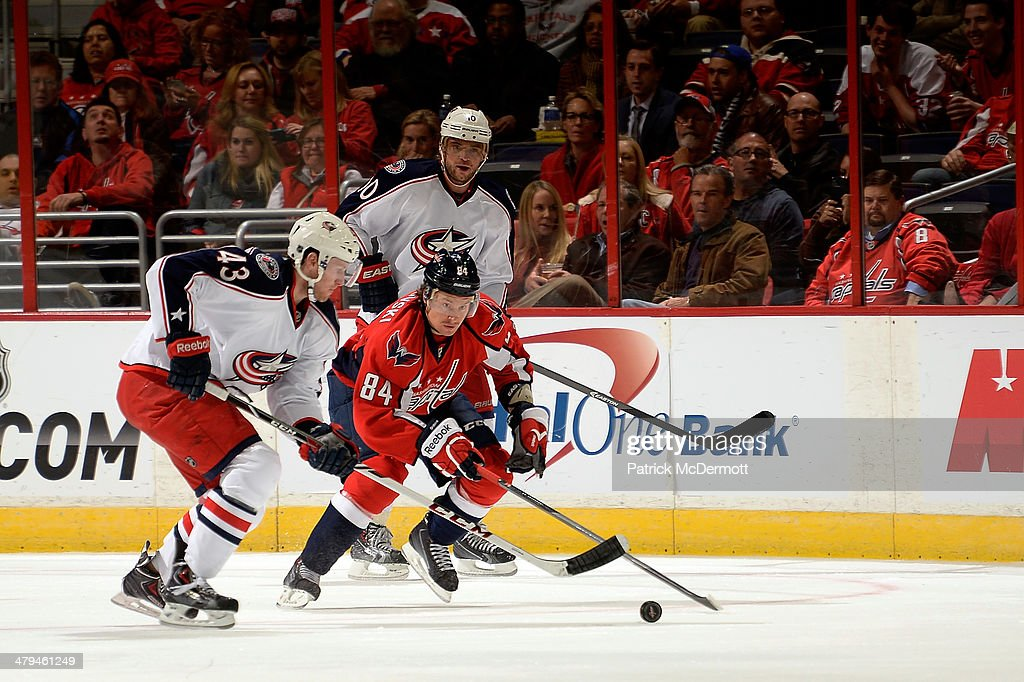 Tom Wilson #43 of the Washington Capitals battles for the puck against Sean Collins #43 of the Columbus Blue Jackets in the first period during an NHL game at Verizon Center on November 12, 2013 in Washington, DC.