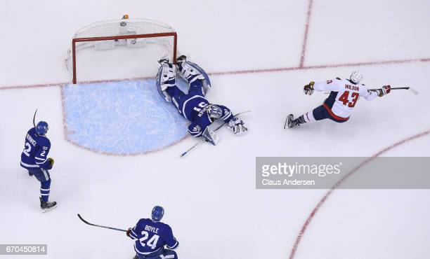 Tom Wilson of the Washington Capitals celebrates a goal against Frederik Andersen of the Toronto Maple Leafs in Game Four of the Eastern Conference...