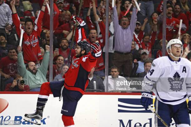Tom Wilson of the Washington Capitals celebrates after scoring the game-winning goal against the Toronto Maple Leafs in overtime in Game One of the...