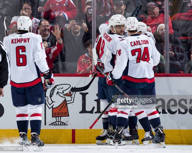 Tom Wilson of the Washington Capitals celebrates his first period goal with teammates Alex Ovechkin John Carlson and Michal Kempny during an NHL game...