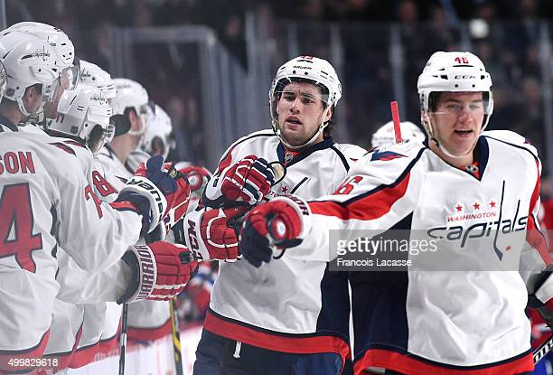 Tom Wilson of the Washington Capitals celebrates his first period goal with teammate against the Montreal Canadiens in the NHL game at the Bell...