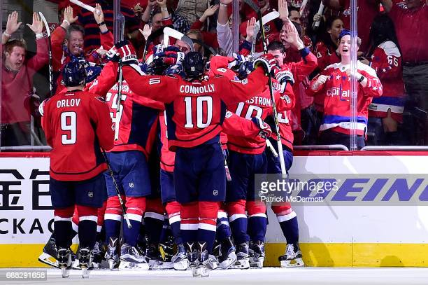 Tom Wilson of the Washington Capitals celebrates his game winning overtime goal against the Toronto Maple Leafs in Game One of the Eastern Conference...