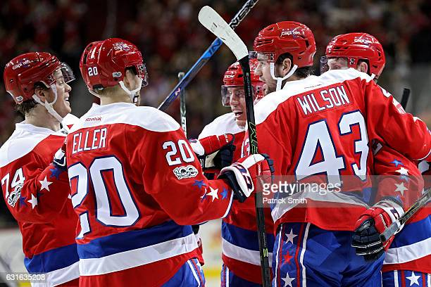 Tom Wilson of the Washington Capitals celebrates his goal with teammates against the Chicago Blackhawks during the second period at Verizon Center on...