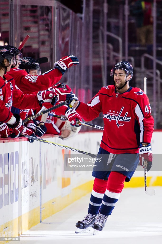 Tom Wilson #43 of the Washington Capitals celebrates with his teammates after scoring an empty net goal in the third period against the Chicago Blackhawks at Capital One Arena on December 6, 2017 in Washington, DC.