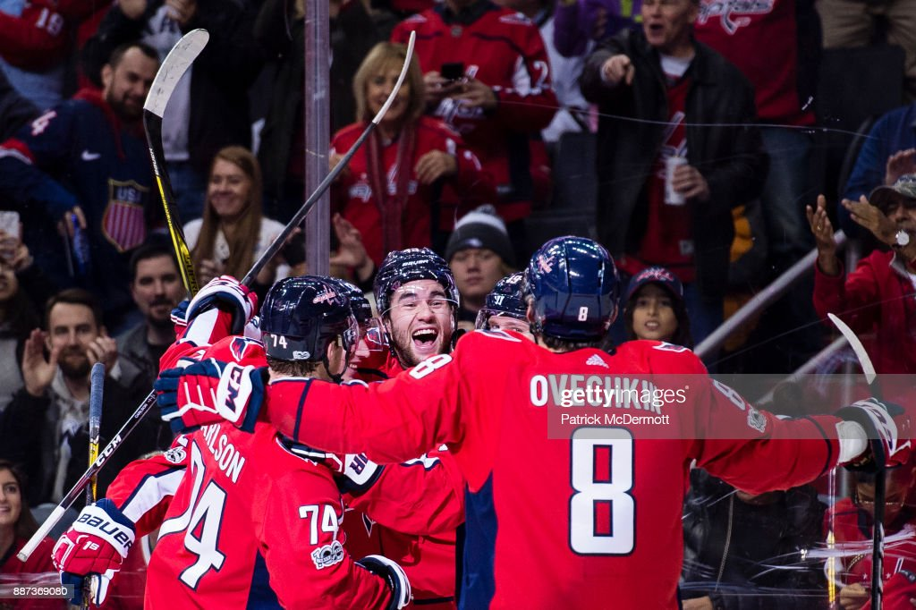 Tom Wilson #43 of the Washington Capitals celebrates with his teammates after scoring a first period goal against the Chicago Blackhawks at Capital One Arena on December 6, 2017 in Washington, DC.