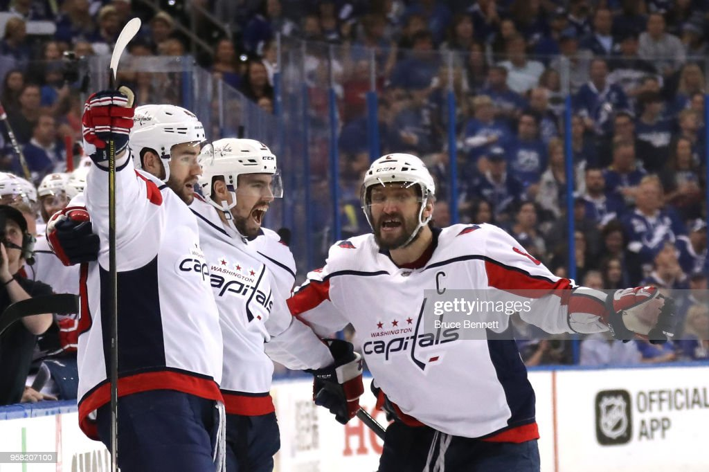 Tom Wilson #43 of the Washington Capitals celebrates with Matt Niskanen #2 and Alex Ovechkin #8 after scoring a goal against Andrei Vasilevskiy #88 of the Tampa Bay Lightning during the first period in Game Two of the Eastern Conference Finals during the 2018 NHL Stanley Cup Playoffs at Amalie Arena on May 13, 2018 in Tampa, Florida.