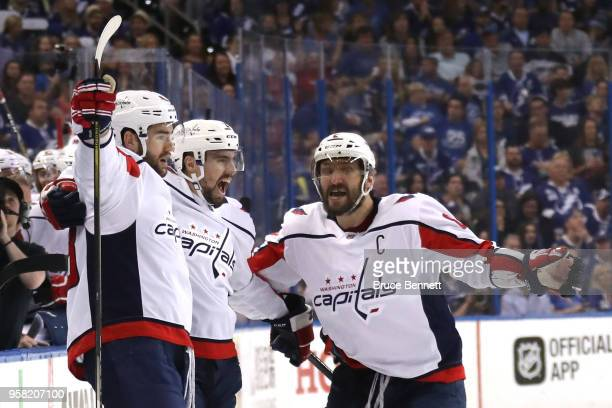 Tom Wilson of the Washington Capitals celebrates with Matt Niskanen and Alex Ovechkin after scoring a goal against Andrei Vasilevskiy of the Tampa...