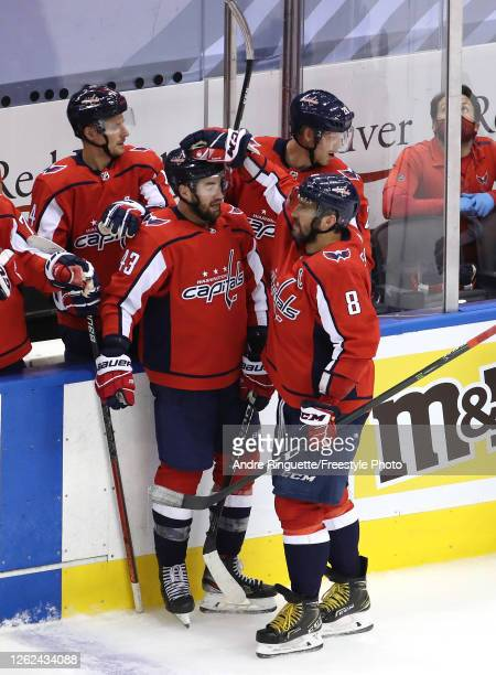Tom Wilson of the Washington Capitals celebrates with teammate Alex Ovechkin after Wilson got the assist on Ovechkin's goal in the second period...