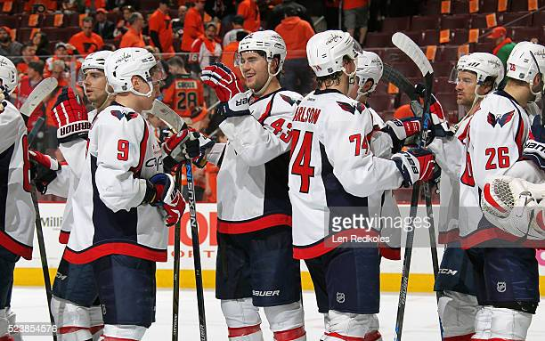 Tom Wilson of the Washington Capitals celebrates with teammates after defeating the Philadelphia Flyers 61 in Game Three of the Eastern Conference...