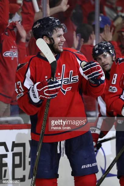 Tom Wilson of the Washington Capitals celebrates with teammates after scoring the gamewinning goal against the Toronto Maple Leafs in overtime in...