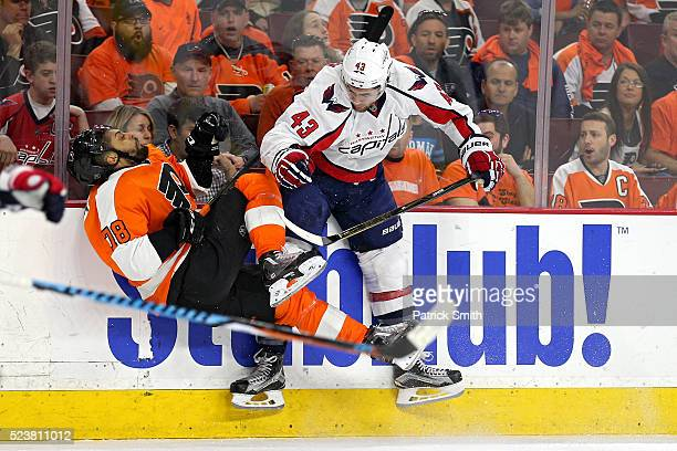Tom Wilson of the Washington Capitals checks PierreEdouard Bellemare of the Philadelphia Flyers during the first period in Game Six of the Eastern...