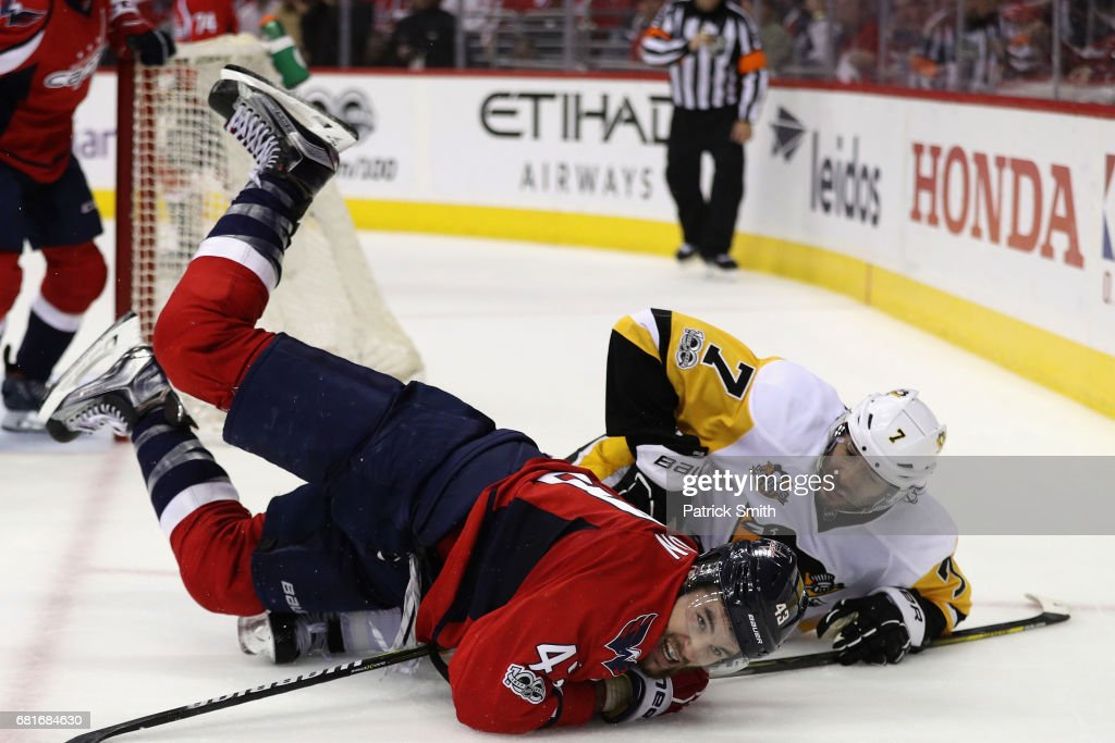 Tom Wilson #43 of the Washington Capitals collides with Matt Cullen #7 of the Pittsburgh Penguins in the second period in Game Seven of the Eastern Conference Second Round during the 2017 NHL Stanley Cup Playoffs at Verizon Center on May 10, 2017 in Washington, DC.