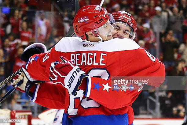 Tom Wilson of the Washington Capitals congratulates Jay Beagle after he scored against the Montreal Canadiens during the second period at Verizon...