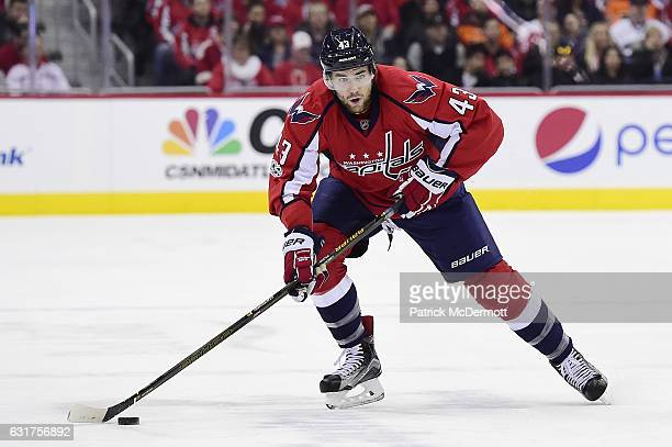 Tom Wilson of the Washington Capitals controls the puck in the first period during an NHL game against the Philadelphia Flyers at Verizon Center on...