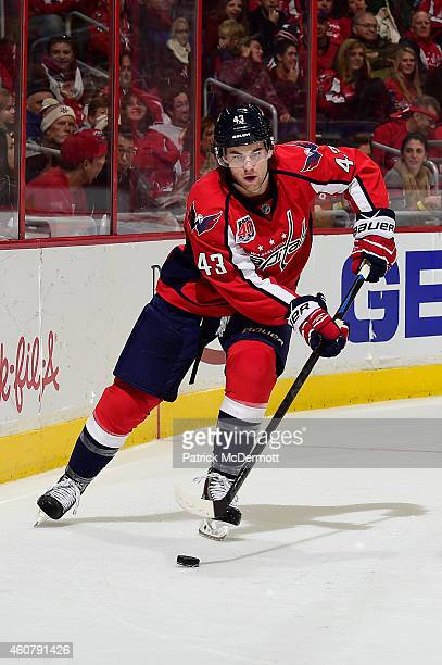 Tom Wilson of the Washington Capitals controls the puck in the third period against the Ottawa Senators during an NHL game at Verizon Center on...