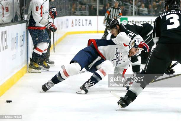 Tom Wilson of the Washington Capitals falls as he fights for control of the puck with Dustin Brown of the Los Angeles Kings during the third period...