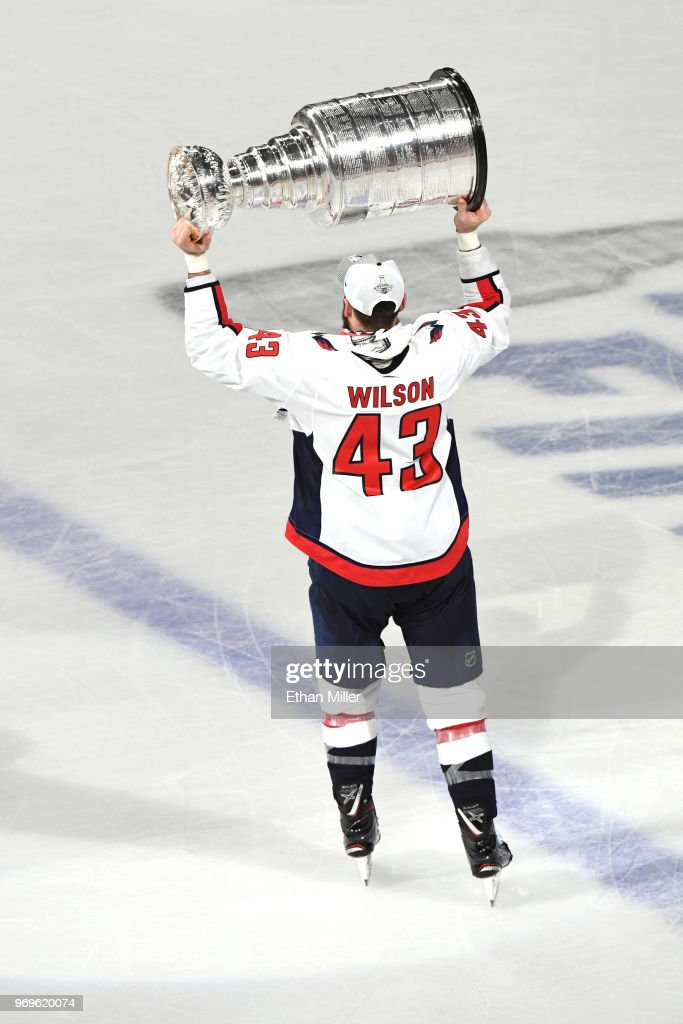 free shipping 098d4 20296 Tom Wilson of the Washington Capitals hoists the Stanley Cup ...
