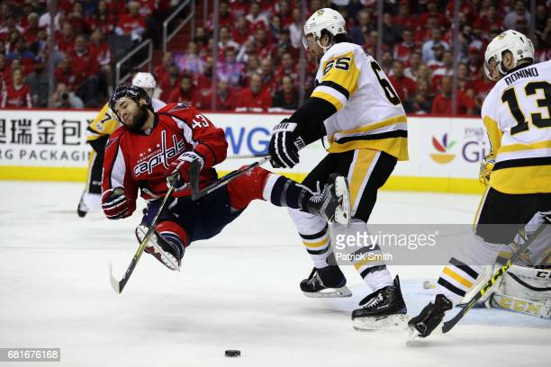 Tom Wilson of the Washington Capitals is checked by Ron Hainsey of the Pittsburgh Penguins in the first period in Game Seven of the Eastern...