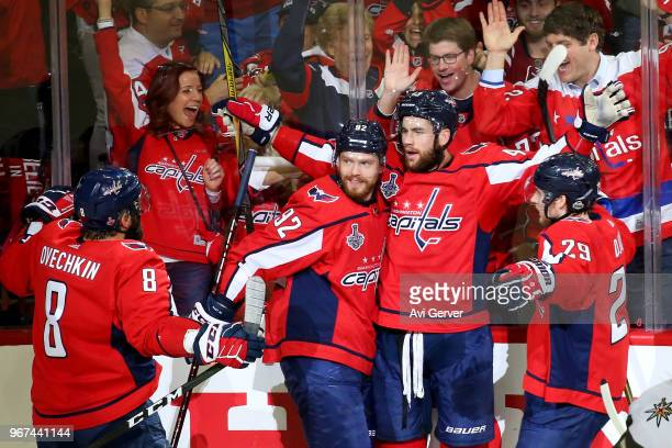 Tom Wilson of the Washington Capitals is congratulated by his teammates after scoring a firstperiod goal against the Vegas Golden Knights in Game...