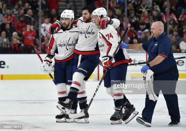 Tom Wilson of the Washington Capitals is helped off the ice after a hit by Ryan Reaves of the Vegas Golden Knights during the second period of a game...