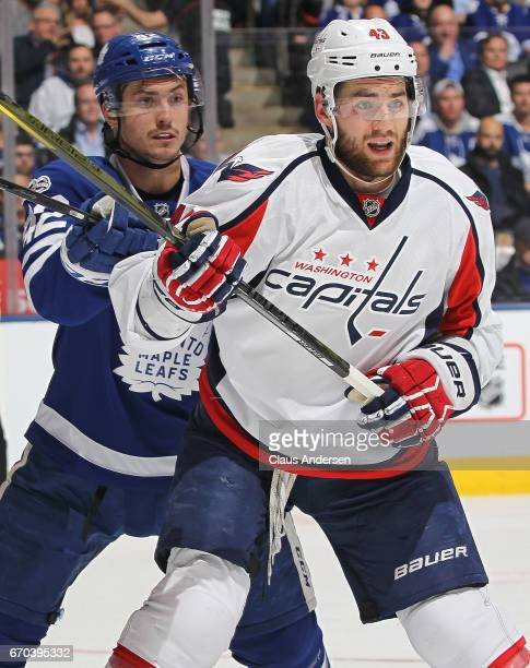 Tom Wilson of the Washington Capitals is watched closely by Tyler Bozak of the Toronto Maple Leafs in Game Four of the Eastern Conference...