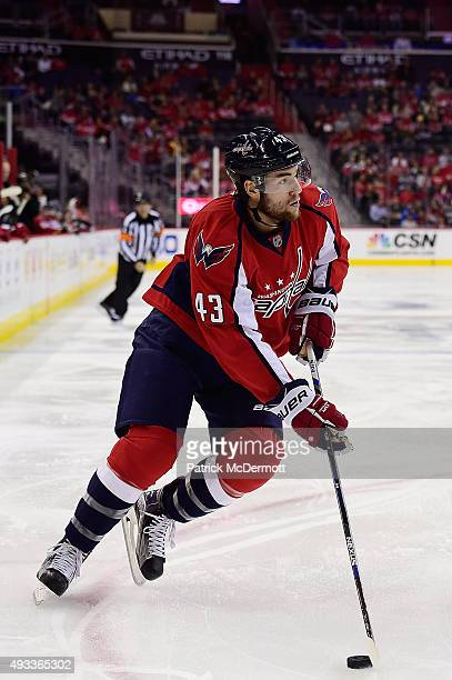 Tom Wilson of the Washington Capitals moves the puck up ice in the first period against the Carolina Hurricanes during an NHL game at Verizon Center...
