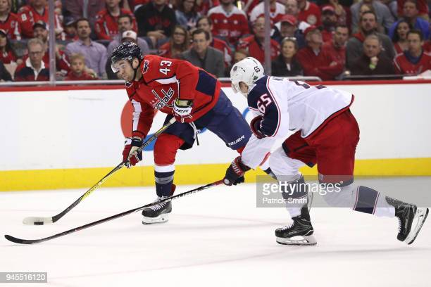 Tom Wilson of the Washington Capitals shoots in front of Markus Nutivaara of the Columbus Blue Jackets in the second period in Game One of the...