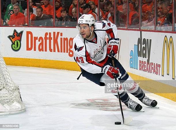 Tom Wilson of the Washington Capitals skates the puck against the Philadelphia Flyers in Game Six of the Eastern Conference First Round during the...