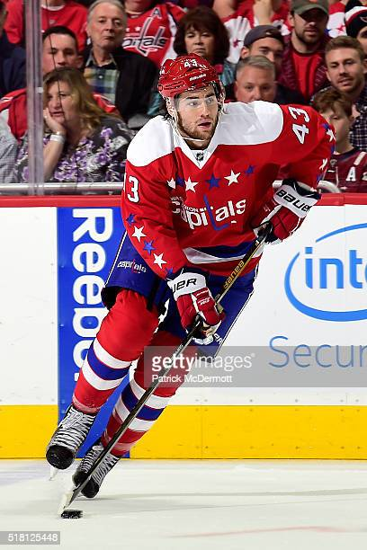 Tom Wilson of the Washington Capitals skates with the puck in the third period during their game against the St Louis Blues at Verizon Center on...