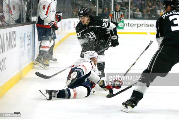 Tom Wilson of the Washington Capitals slides after falling as Dustin Brown of the Los Angeles Kings looks on during the third period at Staples...