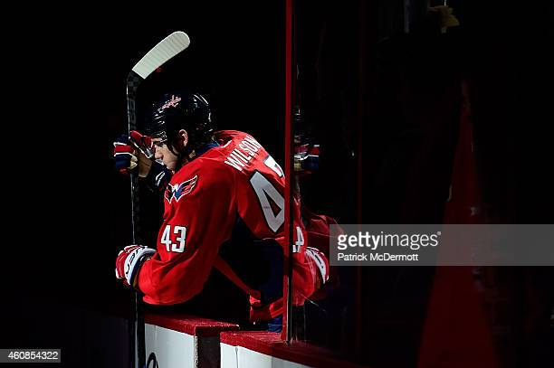 Tom Wilson of the Washington Capitals steps onto the ice before the start of an NHL game against the Ottawa Senators at Verizon Center on December 22...