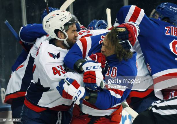 Tom Wilson of the Washington Capitals takes a roughing penalty during the second period against Artemi Panarin of the New York Rangers at Madison...