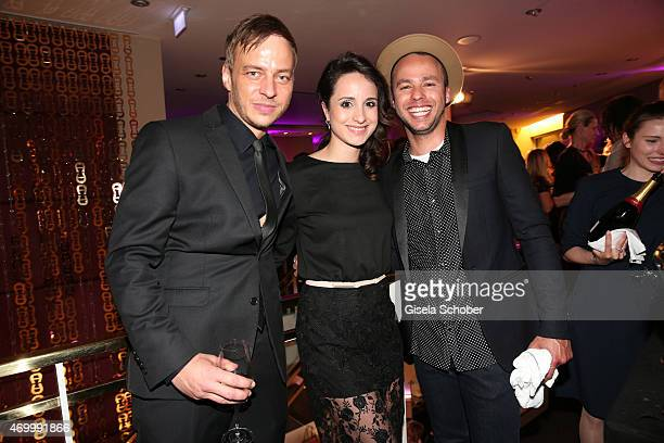 Tom Wlaschiha, Stephanie Stumph and Singer Marlon Roudette during the 50th Anniversary of AIGNER on April 16, 2015 in Munich, Germany.