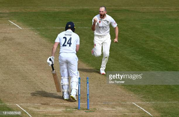 Tom Wood of Derbyshire is bowled by Ben Raine of Durham who celebrates during day four of the LV= Insurance County Championship match between Durham...