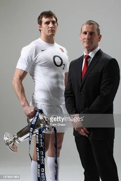 Tom Wood of England and Head Coach Stuart Lancaster of England pose with the RBS Six Nations Trophy during the RBS Six Nations Launch at The...