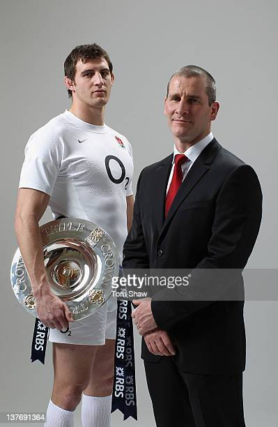 Tom Wood of England and Head Coach Stuart Lancaster of England pose with the Triple Crown during the RBS Six Nations Launch at The Hurlingham Club on...