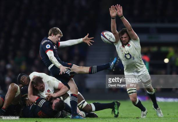 Tom Wood of England attempts to block the clearing kick of Baptiste Serin of France during the RBS Six Nations match between England and France at...