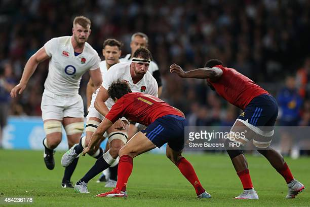 Tom Wood of England charges into Francois TrinhDuc of France during the QBE International match between England and France at Twickenham Stadium on...