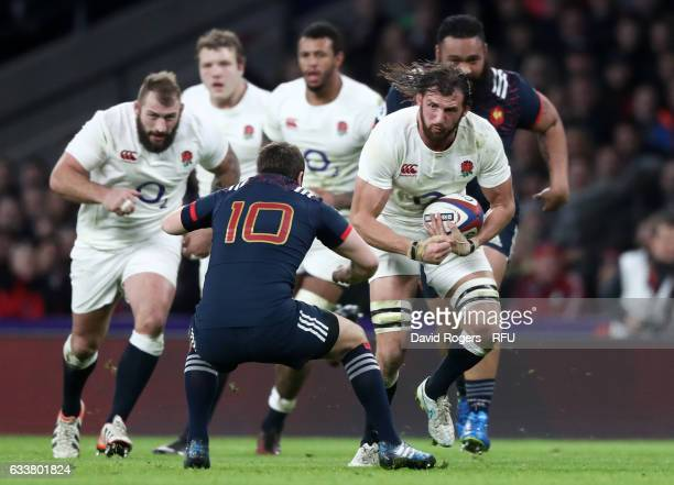 Tom Wood of England charges towards Camille Lopez of France during the RBS Six Nations match between England and France at Twickenham Stadium on...