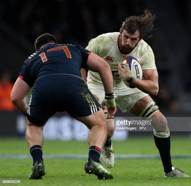 Tom Wood of England is challenged by Rabah Slimani of France during the RBS Six Nations match between England and France at Twickenham Stadium on...