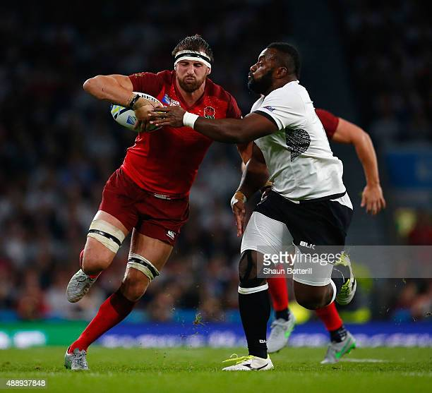 Tom Wood of England is tackled by Peni Ravai of Fiji during the 2015 Rugby World Cup Pool A match between England and Fiji at Twickenham Stadium on...