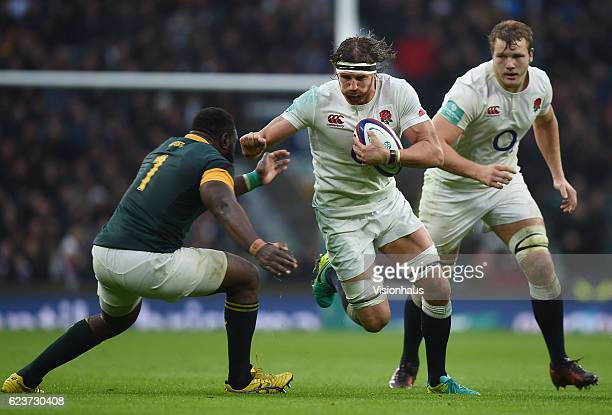 Tom Wood of England is tackled by Tendai Mtawarira of South Africa during the Old Mutual Wealth Series match between England and South Africa at...