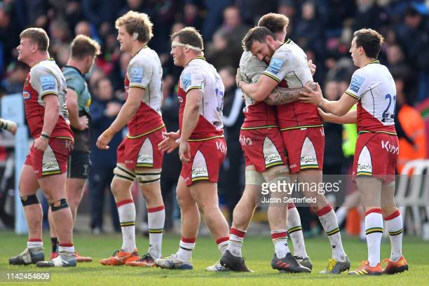 Tom Wood of Northampton celebrates with Teimana Harrison of Northampton after the Gallagher Premiership Rugby match between Harlequins and...