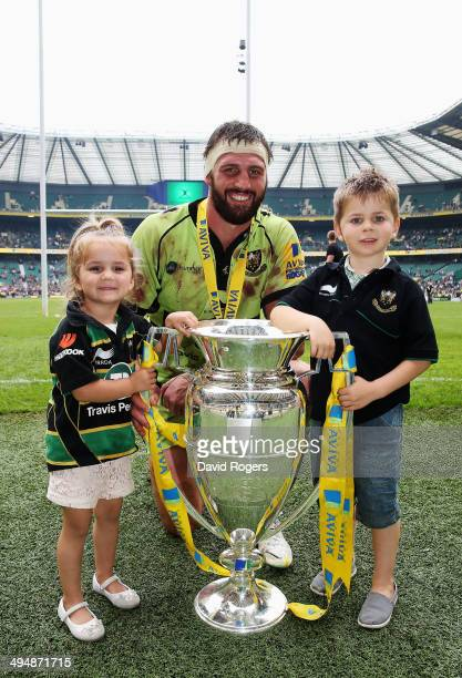 Tom Wood of Northampton Saints and children Isabella and Oliver pose with the Aviva trohpy during the Aviva Premiership Final between Saracens and...