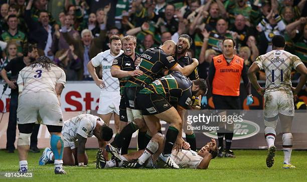 Tom Wood of Northampton Saints celebrates after scoring the last minute match winning try during the Aviva Premiership semi final match between...